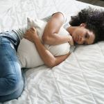 Emotional healing for broken hearts showing a woman in bed