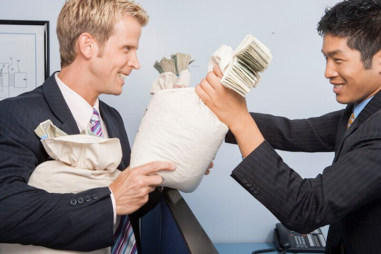 beware of covetousness showing a man holding a bag of money