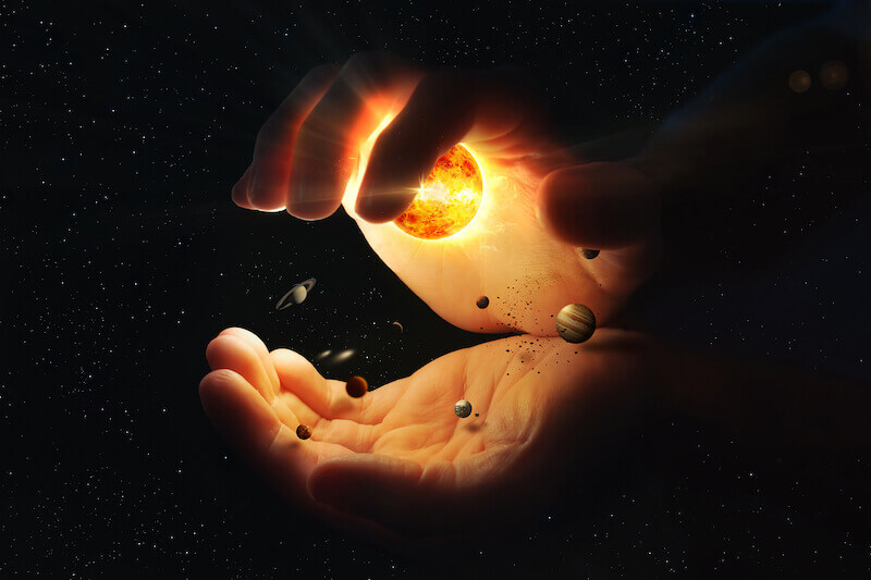 created by God and for God showing a hand holding the universe