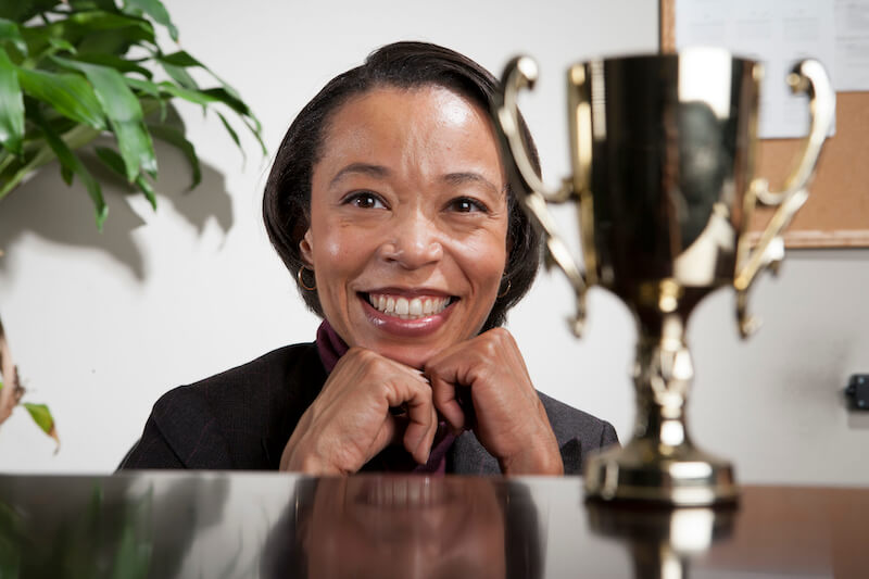 give to every man according to his works showing a black woman with a trophy