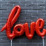 his banner over me was love showing the word love in balloons
