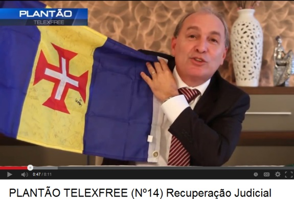 In 2013, Carlos Costa displayed the flag of Madeira while announcing TelexFree was seeking bankruptcy protection.