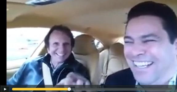 Racing legend Emerson Fittipaldi somehow ended up in a car with TelexFree figure Sann Rodrigues. Source: Video on DailyMotion.
