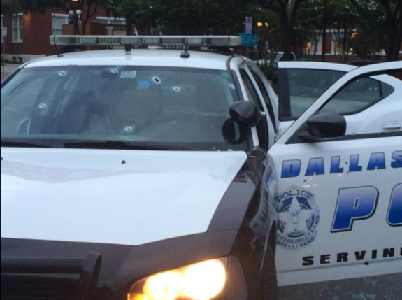This police car was hit by a hail of gunfire outside of Dallas Police Headquarters this morning. Source: Dallas Police Departmenta, via Twitter.