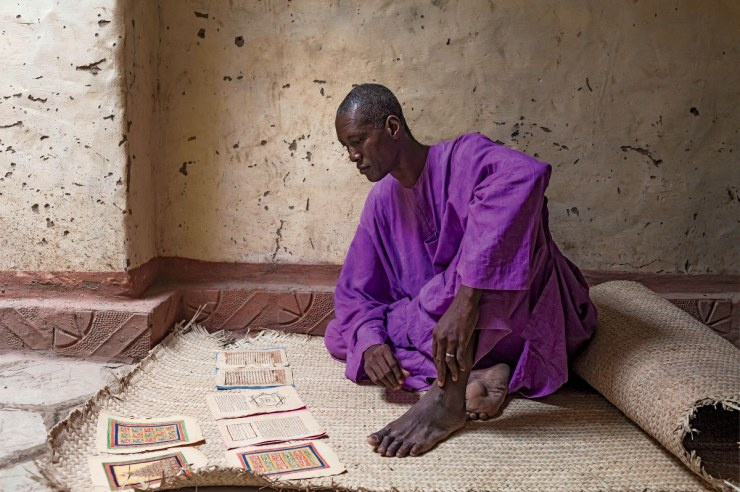 Koranic expert Dramane Moulaye Haidara, like many in Timbuktu, hid his manuscripts ­during the jihadi occupation.   Photo: Marco Di Lauro/Reportage by Getty Images