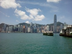 The Star Ferry crossing Victoria Harbour with Hong Kong Island on the background