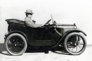 Herbert Austin driving and Austin Seven