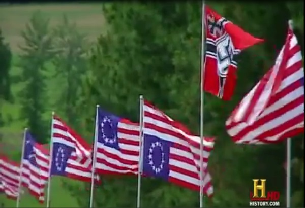 Neo-Nazis fly inverted American flags, as a