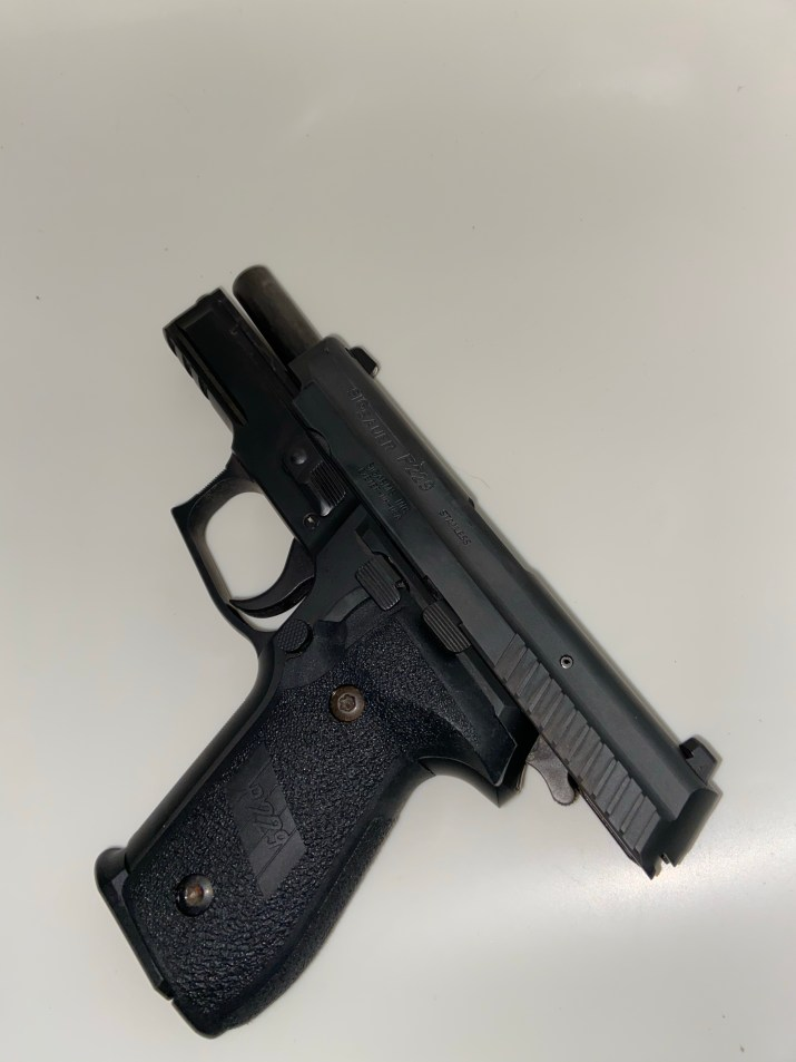 Slide back on a SIG SAUER P229 Left Side View