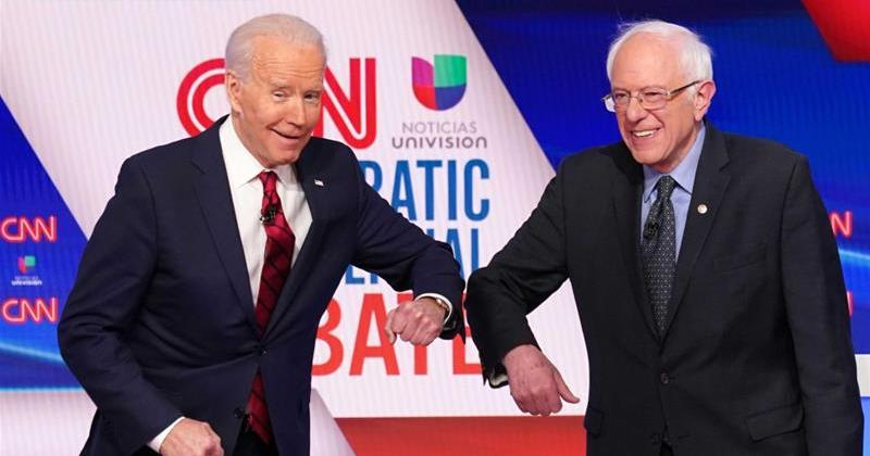Bernie and Biden bumping elbows