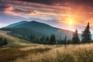 sunrise above the peaks of smoky mountains
