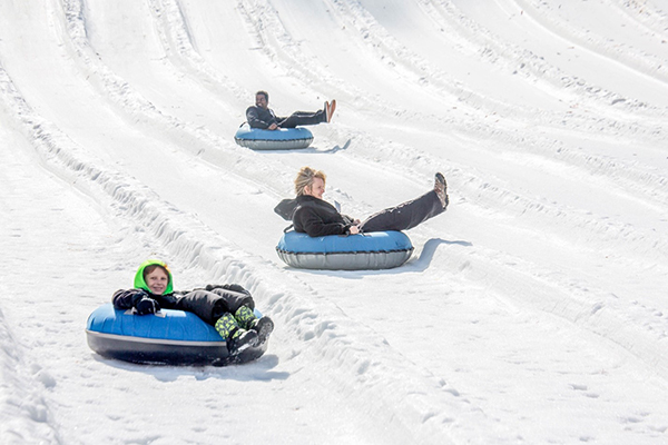Tubers riding down the snow slopes at Ober Gatlinburg.
