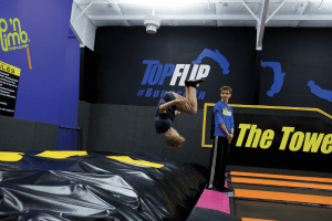 A child doing a back flip at Top Jump Trampoline Center in Pigeon Forge, TN