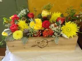 Brides will continue to have beautifully handcrafted boxes and vases (mason jars too) to hold their flowers; a bride here had a handcrafted wooden box, beautiful!