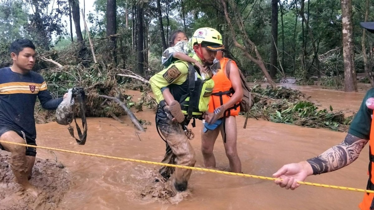 Baby saved from Laos dam disaster by Thai cave rescue volunteers