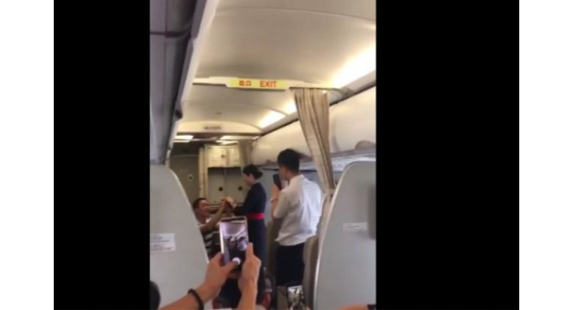 Flight attendant fired after boyfriend proposed to her mid-flight