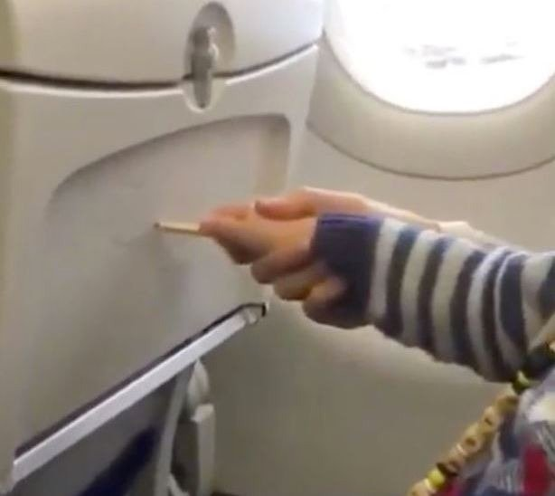 Video: Parents slammed for allowing toddler to graffiti aircraft