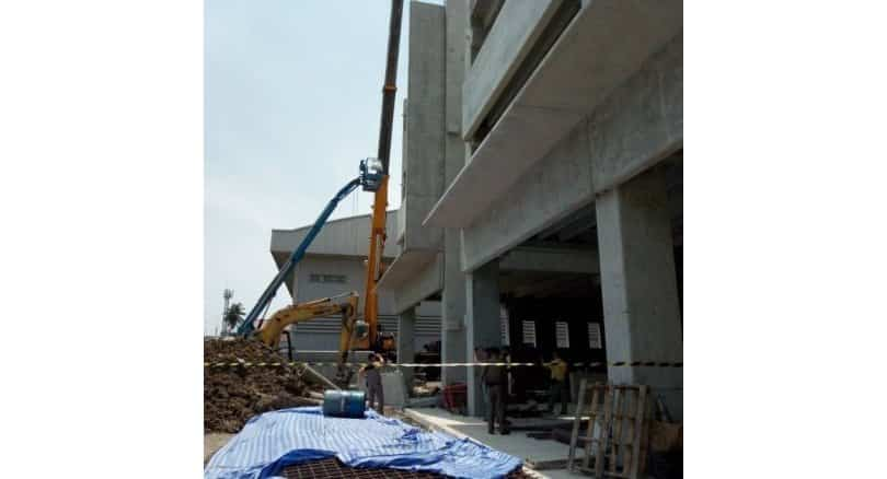 Two construction workers die after concrete wall falls several metres. A 6-tonne precast-concrete wall fell several metres during installation at a