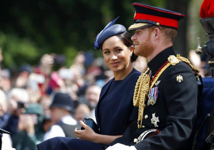 FILE - In this Saturday, June 8, 2019 file photo, Britain's Meghan, the Duchess of Sussex and Prince Harry ride in a carriage to attend the annual Trooping the Colour Ceremony in London. Kensington Palace says on Thursday, June 20 the Duke and Duchess of Sussex will be starting their own foundation to support their charitable endeavors, formally spinning off from the entity Prince Harry and Prince William established together a decade ago. Photo: Frank Augstein / AP File