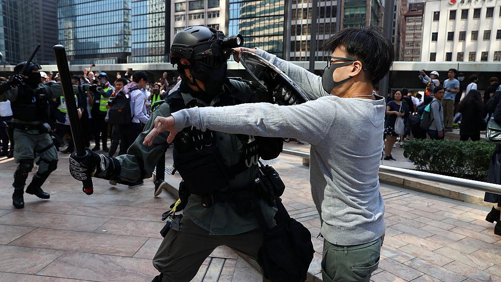 China tells U.S. to back off as Hong Kong violence escalates