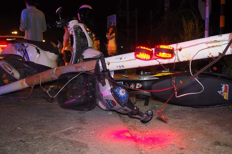 Eleven injured, 12 vehicles damaged pickup driver crashes railroad crossing barriers