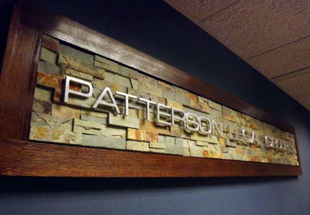 Gary Patterson designed the Patterson Legal Group sign that welcomes clients above the entry way door