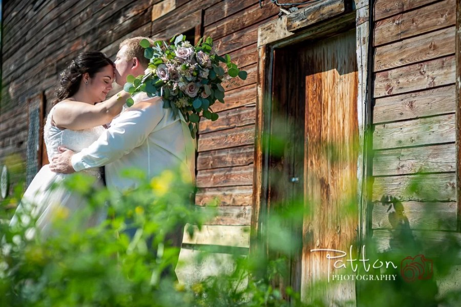 A quiet moment between a Calgary bride and groom after a Saskatoon Farm wedding
