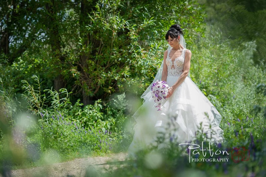 Calgary bride quiet moment alone on treed path