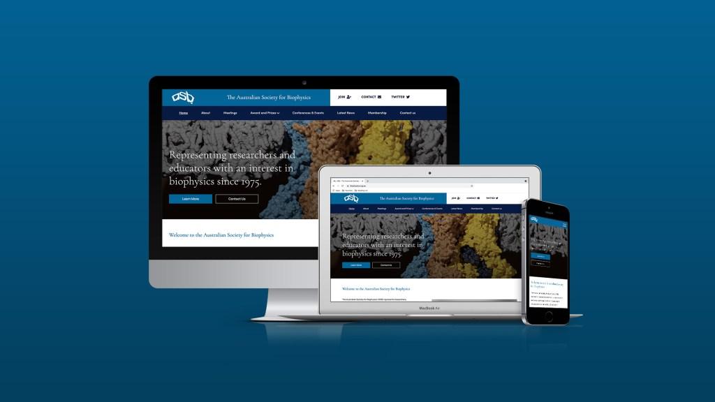 Mockup of the Australian Society for Biophysics website on a desktop, laptop and smartphone against a dark aqua background.
