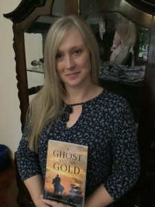 Roberta Cheadle holding her latest book