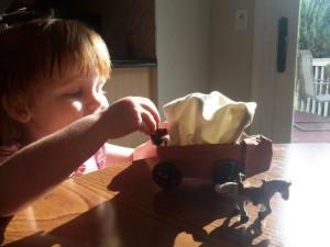 "Caroline ""played"" with the wagon."
