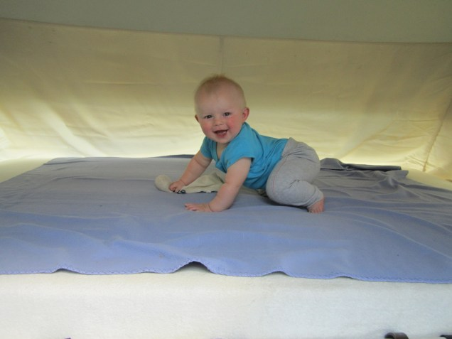 Grandson bouncing in our bed!