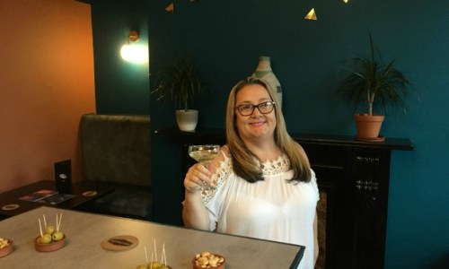 Carole enjoying a glass of fizz at bar Padron #barpadron #tapas #spanishfood #restaurantscheltenham #preshowdrinks