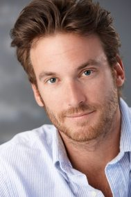 Closeup portrait of handsome mid-adult man looking at camera.