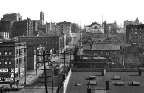 THEN: A circa 1923 view looks south on Eighth Avenue over Pike Street, at bottom left.