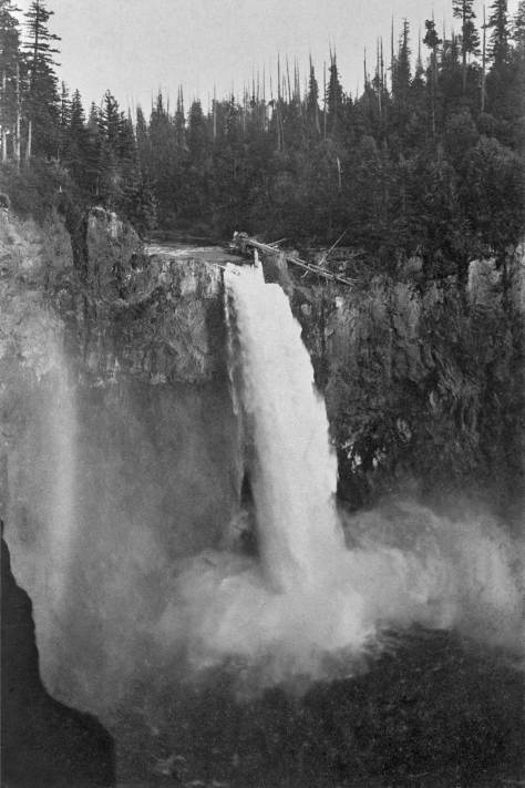 "An early view of the falls with ""Seattle Rock"" at the top between the falls and the fallen tree caught behind the rock.  The rock was blasted away in order to create the pool behind the falls for development of the power plant above and beneath it.   Photo by Davidson from the 1890s."