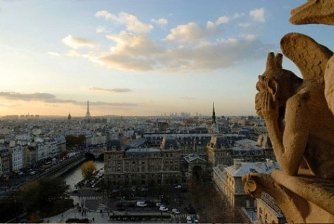 A gargoyle watches over Paris from its perch on Notre Dame.