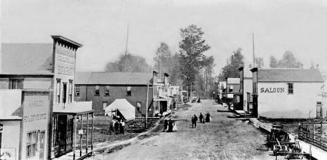 Our earliest view east from the N.P. tracks - or above them - down Main Street.  We give it a circa date with wild speculation - ca.1895