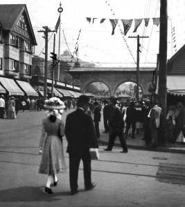 THEN: For the four-plus months of the 1909 Alaska-Yukon-Pacific Exposition, the center of commerce and pedestrian energy on University Way moved two blocks south from University Station on Northeast 42nd Street to here, Northeast 40th Street, at left.