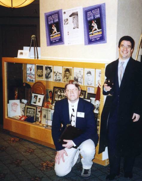 This one is no birthday softball game, but it shows the roots of the friendship of Dave and me. This is from February 1999 at the Seattle Post-Intelligencer Sports Star of the Year banquet. Dave and I were the core of reviving and expanding the Hutch Award, as you can see from the posters above. In the display case is Dave's assembly of his best Fred Hutchinson memorabilia. What a bear it was to get that heavy case to the Sheraton from the Hutch. It was the definition of heavy, and it was only half a display case (Dave is standing in front of the hastily covered-up mid-section of the case). Whew.