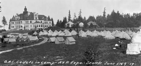 THEN: When the Oregon Cadets raised their tents on the Denny Hall lawn in 1909 they were almost venerable. Founded in 1873, the Cadets survive today as Oregon State University's ROTC. Geneticist Linus C. Pauling, twice Nobel laureate, is surely the school's most famous cadet corporal. (courtesy, University of Washington Libraries)