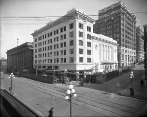 THEN: With the stone federal post office at its shoulder – to the left – and the mostly brick Cobb Building behind, the tiled Pantages Theatre at Third Ave. and University Street gave a glow to the block. (Courtesy Lawton Gowey)