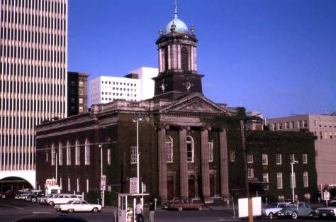 Lawton Gowey's snapshot of the Plymouth Congregational sanctuary of 1912 during its last times.  The photograph looks across 6th Avenue, and Lawton has dated the slide Aug. 5, 1964