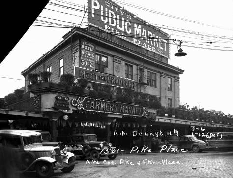 """The Leland Hotel at the Pike Place Public Market and the covered arcades beyond it, in a """"tax photo"""" recorded in the late 1930s.  Courtesy, Muncipal Archive."""