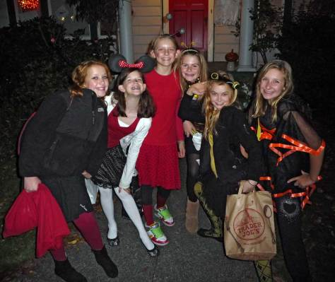 . . . but around the corner in front of another neighbor's candy porch I come upon a gaggle of six chatty teens who on hearing that I write for a newspaper insist on having their photo taken with a promise to see it published.  Here it is.