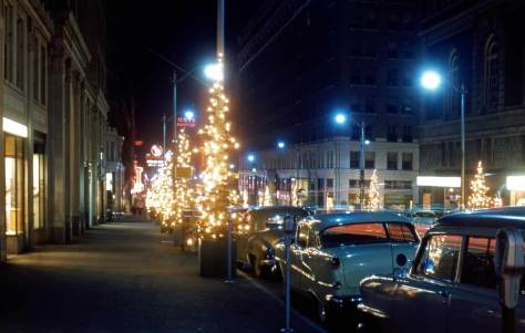 Looking north on 4th Avenue across University Street.  Part of the Olympia Hotel is on the right. The date: 12/28/47.
