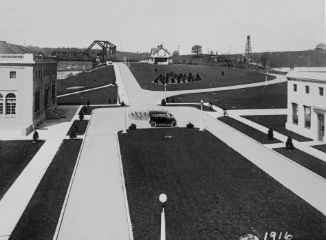THEN: Looking east from the roof of the still standing testing lab, the Lock's Administration Building (from which this photograph was borrowed) appears on the left, and the district engineer's home, the Cavanaugh House (still standing) on the center horizon. (Photo courtesy Army Corps of Engineers at Chittenden Locks)