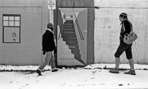 Paula and Bill head for faux stairway to Cascade Playground on Minor Avenue.  Our home was to the right.  1977 snow.
