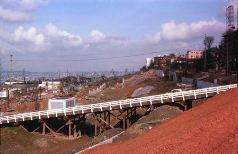 "Another Frank Shaw of the I-5 ""Seattle Freeway"" construction.  This one looks north from near Olive and over the Denny Way temporary timber trestle (I believe).  It dates from 1963."