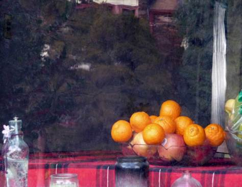 Early this afternoon I came upon this still life with oranges seen through a neighbors window, and not being too revealing except for the fruit and the bottles (or parts of them) I recorded it.